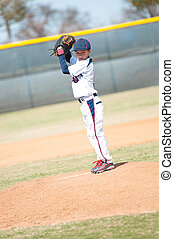 Little league pitcher starting his wind up. - Little league...