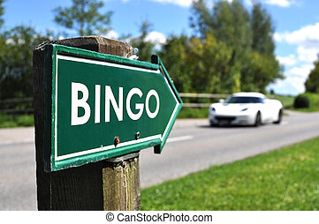 BINGO sign against sportive car on the rural road