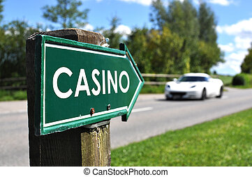 CASINO sign against sportive car on the rural road