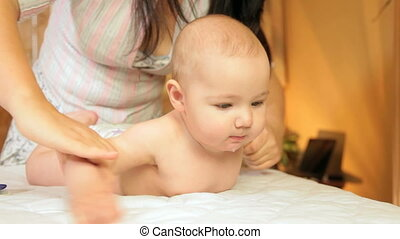Infant massage - baby boy enjoying massage