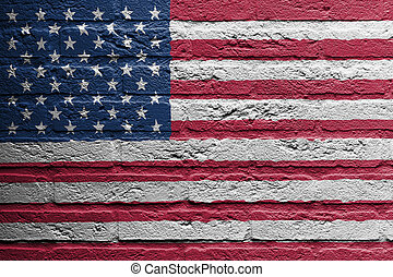 Brick wall with a painting of a flag, USA - Brick wall with...