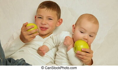 Two funny kids with apples - Two funny brothers with apples