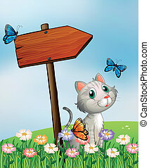 A cat with three butterflies beside the wooden arrow board