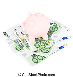 hundred euro banknotes and coinbank - Piggy coinbank on a...