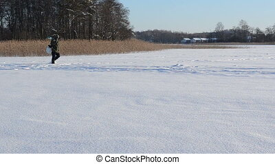 fisherman winter hobby - ice fisherman carry drill and...