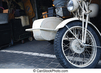 Old white motorcycle - Old vintage motorcycle with sidecar.