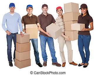 Group of delivery people with boxes. Isolated on white