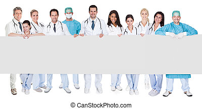 Group of doctors presenting empty banner Isolated on white