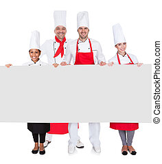 Group of chefs presenting empty banner Isolated on white