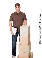 Portrait of delivery man doing paperwork Isolated on white...