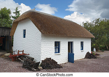 Irish Thatched Cottage - Old Irish thatched cottage with...