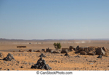 Convoy of cars over desert in Morocco