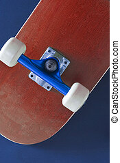 skateboard - the underside of a red coloured skateboard on a...