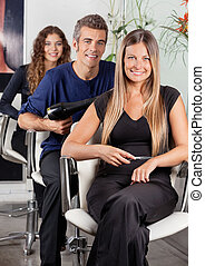 Confident Team Of Hairdressers At Salon - Portrait of...
