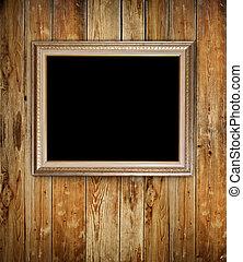 Vintage frame on wood background