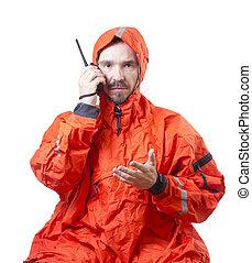 Man in storm cog talking on marine radio