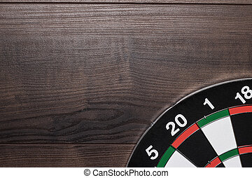 target on brown wooden table - target on the brown wooden...