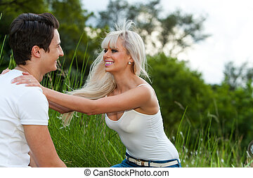 Romantic couple showing affection outdoors.