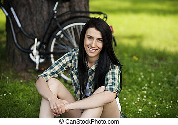 Beautiful young woman resting in park