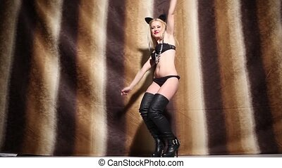 Blonde girl dancing - Pretty blonde girl wearing cat ears,...