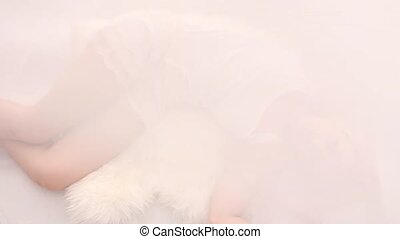 Girl in white bed, seen from above - Blonde girl wearing...