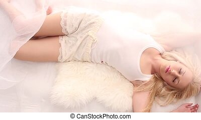 Beautiful girl in white bed - Blonde girl wearing white lace...
