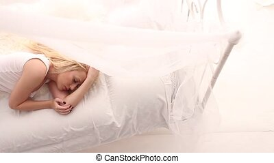 Sleeping girl in white bed - Blonde girl wearing white lace...