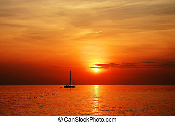 sailing boat sunset at kata beach phuket