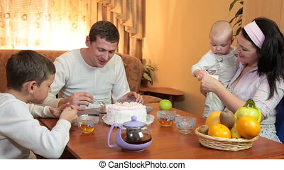 Family enjoying dessert at home - Family sitting around the...