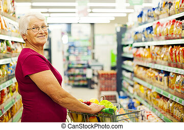Portrait of senior woman at supermarket