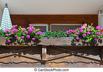 Wooden Loft Decorated With Fresh Flowers in the Bavarian...