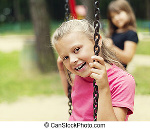 Happy little kid on swing