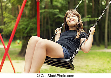 Girl having fun on swing