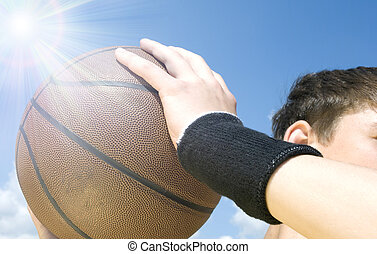 basketball action - teen with ball (focus point on it),...