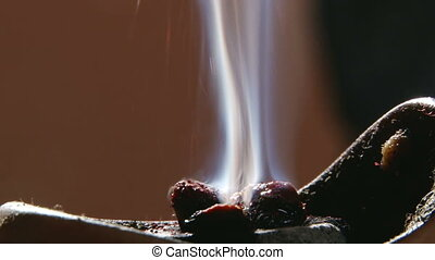 Burning incense, sparks