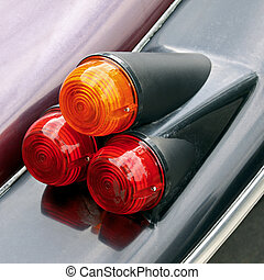 Car tail lights - Three tail lights of an old classic car