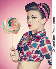 Retro sexy woman with large lollipop