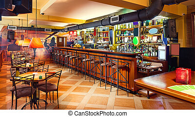 Pub interior - Interior of a modern pub in orange and wooden...