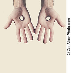 Two hands with holes - Two open hands with holes in the palm...