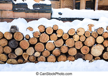Pile of wood covered by snow