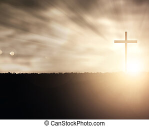 Sunset Cross - A Christian cross at sunset with light flares...