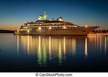 Cruise liner - Modern cruise liner in the harbor at night.
