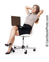 Businesswoman with laptop relaxing on office chair
