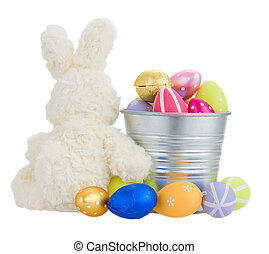 egg hunt - easter rabbit with metal pot full of eggs isolted...