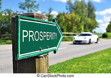 PROSPERITY sign against road and sportive car
