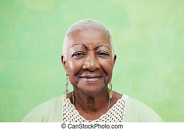 Old black woman portrait, lady in elegant clothes smiling on...