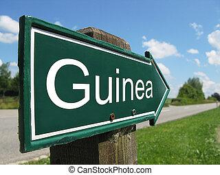 Guinea signpost along a rural road
