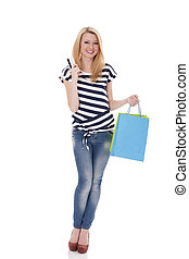 Smiling shopper holding credit card and shopping bags