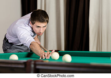 Man playing billiard at gambling house