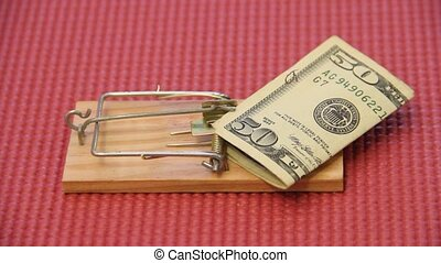 money trap - fifty dollar bill bait on a mousetrap